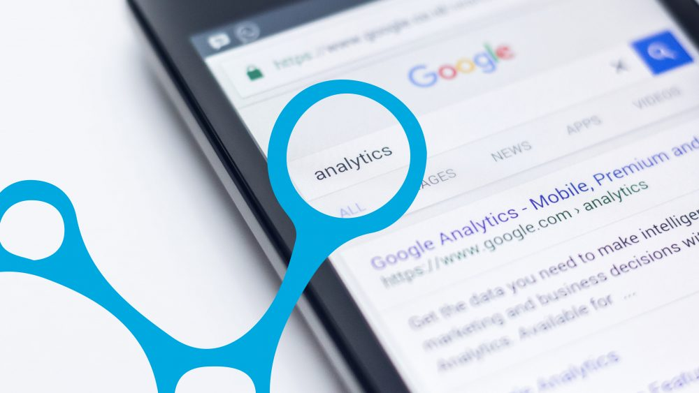 A phone displays the google results for Analytics