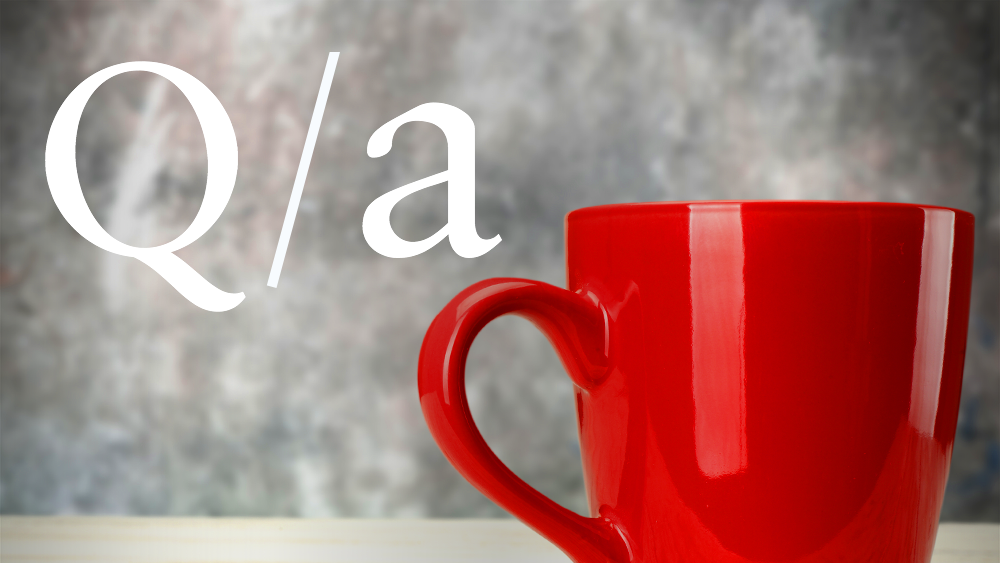 The letters Q and A are positioned over a red coffee cup.