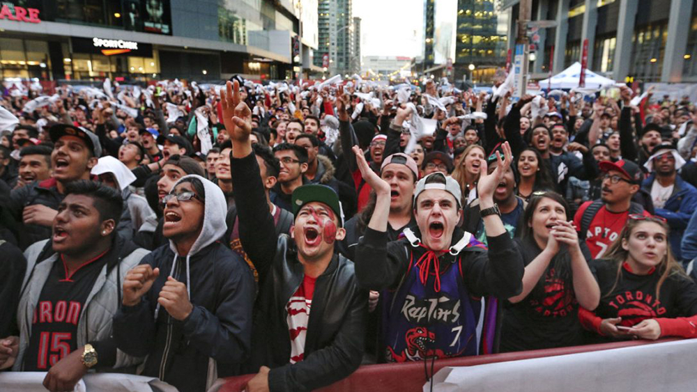 Raptors fans gathered to cheer on their team in Jurassic Park beside the ACC.