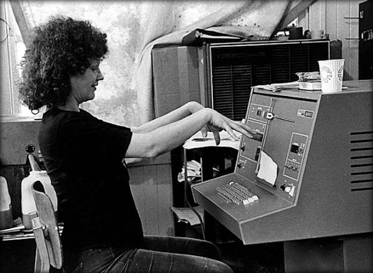 A woman works at a Compugraphic typesetter in 1975.